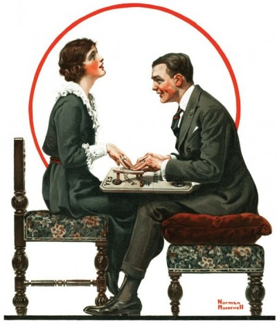 A Normal Rockwell print of a man and woman in dark 20's style clothing. They are using a spirit board. She is gazing into the distance and he is fixed on her. Their knees are touching under the table.